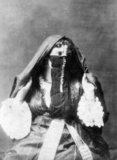 Photograph of a veiiled Arab woman of Algeria produced as a souvenir for the nascent European tourist market.