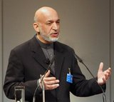 Hamid Karzai (24 December 1957 - ) is the 12th and current President of Afghanistan, taking office on 7 December 2004. He became a dominant political figure after the removal of the Taliban regime in late 2001.<br/><br/>  During the December 2001 International Conference on Afghanistan in Germany, Karzai was selected by prominent Afghan political figures to serve a six-month term as chairman of the Interim administration. He was then chosen for a two-year term as Interim President during the 2002 'loya jirga' (grand assembly) that was held in Kabul.<br/><br/>  After the 2004 presidential election, Karzai was declared winner and became President of the Islamic Republic of Afghanistan. He controversially won a second five-year term in the disputed 2009 presidential election while admitting the elections were flawed.