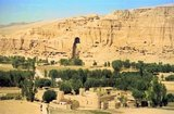 The Buddhas of Bamiyan were two 6th century monumental statues of standing buddhas carved into the side of a cliff in the Bamiyan valley in the Hazarajat region of central Afghanistan, situated 230 km (143 miles) northwest of Kabul at an altitude of 2,500 meters (8,202 ft).<br/><br/>  Built in 507 CE, the larger in 554 CE, the statues represented the classic blended style of Gandhara art. The main bodies were hewn directly from the sandstone cliffs, but details were modeled in mud mixed with straw, coated with stucco. This coating, practically all of which was worn away long ago, was painted to enhance the expressions of the faces, hands and folds of the robes; the larger one was painted carmine red and the smaller one was painted multiple colors.<br/><br/>  The lower parts of the statues' arms were constructed from the same mud-straw mix while supported on wooden armatures. It is believed that the upper parts of their faces were made from great wooden masks or casts. The rows of holes that can be seen in photographs were spaces that held wooden pegs which served to stabilize the outer stucco.<br/><br/>  They were intentionally dynamited and destroyed in 2001 by the Taliban, on orders from leader Mullah Mohammed Omar, after the Taliban government declared that they were 'idols'. International opinion strongly condemned the destruction of the Buddhas, which was viewed as an example of the intolerance of the Taliban. Japan and Switzerland, among others, have pledged support for the rebuilding of the statues.