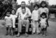 Khmer Rouge leader Saloth Sar, aka Pol Pot, sitting with group of children at Anlong Veng c.1990. The child on his lap is probably Pol Pot's daughter. Others may be his grandchildren, or those of other senior Khmer Rouge cadre. Photo probably by senior KR official.